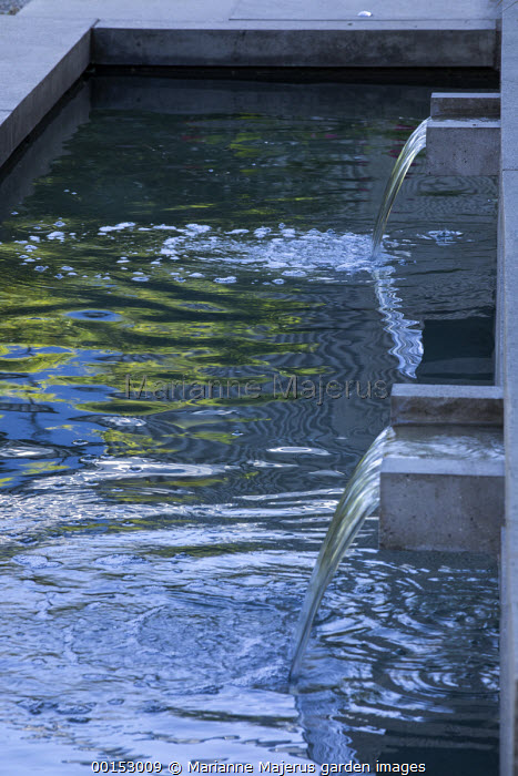Concrete water shutes in formal pool