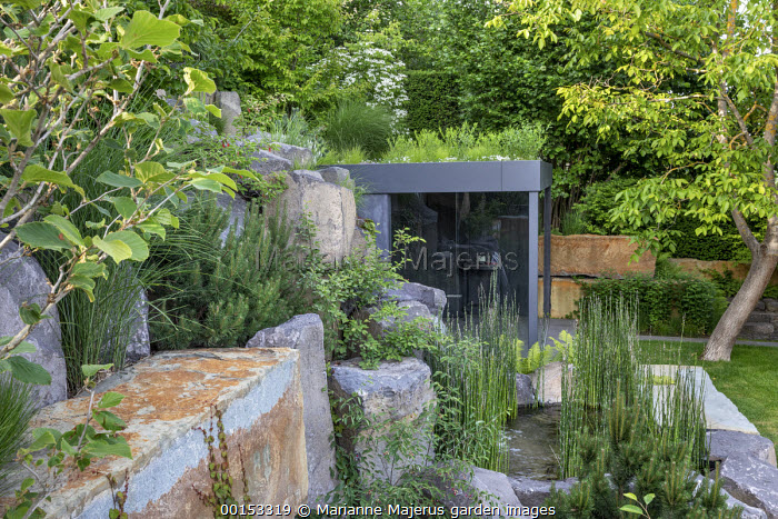 Rock garden, waterfall, contemporary glass pavilion with living green roof, Equisetum hyemale, Pinus sylvestris