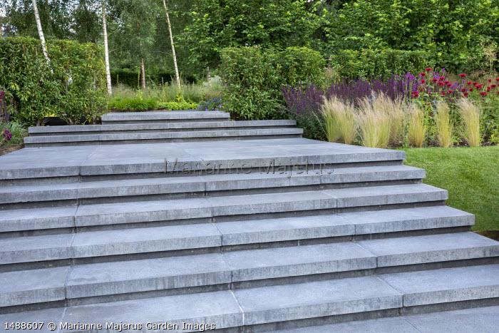 Concrete steps, Stipa tenuissima, Monarda 'Mahogany', Salvia nemorosa 'Caradonna'