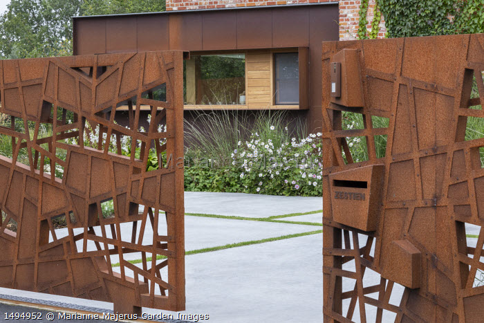 Cor-Ten steel gates, Anemone x hybrida 'Honorine Jobert', polished concrete paving