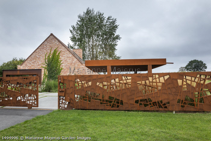 Cor-Ten steel sliding gates and contemporary pavilion shelter