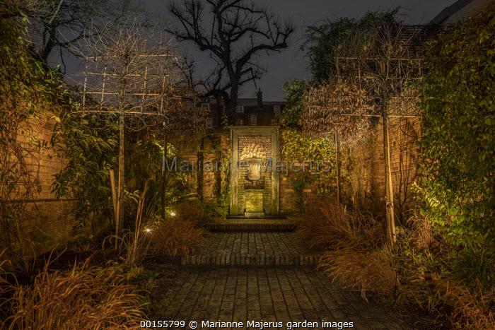Formal town garden, pleached hornbeam screens, shell fountain, wide brick steps, Hakonechloa macra