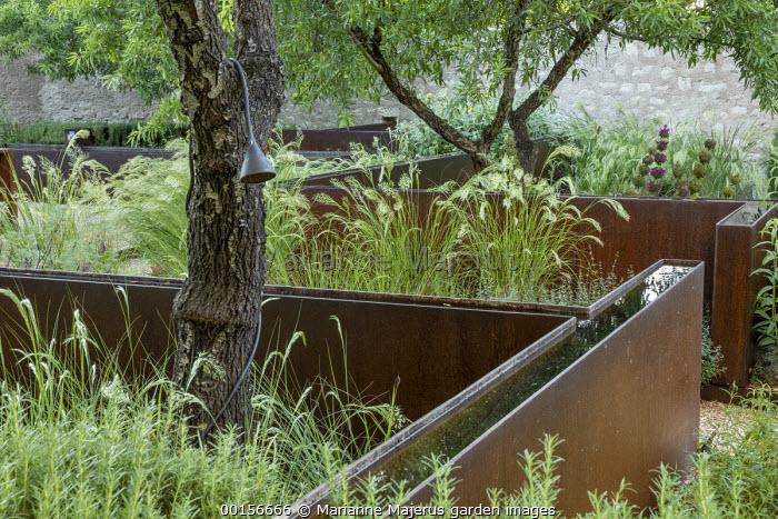 Raised steel rills in mediterranean courtyard