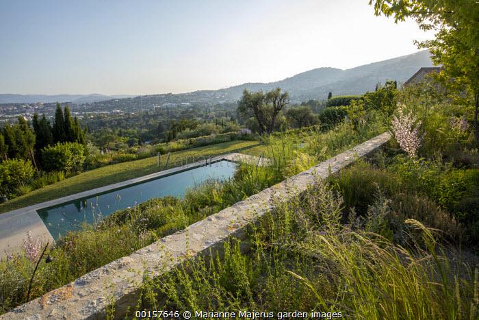 Mediterranean terraced garden, swimming pool, stone wall