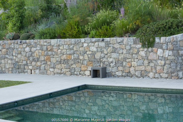 Swimming pool terrace, stone wall