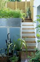 Split-level garden, steel planters, steps, glass panels