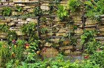 Gabions, stone, metal mesh, ferns
