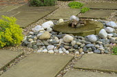 Bubbling millstone water feature, pebbles
