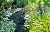 Upended slate path, Hakonechloa macra, Briza maxima, pebbles, driftwood