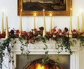 Ivy and rose decoration above fireplace