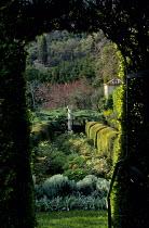 View through yew arch to rose garden