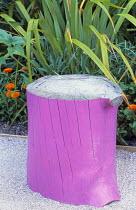 Pink painted log seat