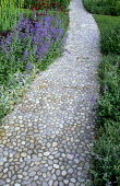 Pebble mosaic path edged with salvia