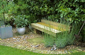Wooden bench, lawn with brick edging, lavender
