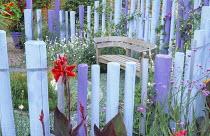 Pastel palisade enclosure, wooden bench by Gaze Burvill, canna, vervena bonariensis