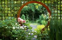 Moongate, peonies, roses, irises