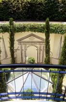 View into basement garden, rooflight, linework mural, Cupressus sempervirens 'Stricta',   Hedera helix 'Glacier'