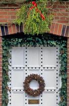 Spruce garlands, pine cones, wreath, mistletoe