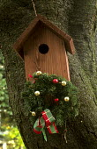 Bird house, wreath with baubles
