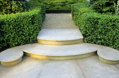 Curved Portland stone steps, box hedge, view to knot garden