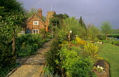View of cottage and church near river Avon, rainbow