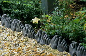 Path edging made of foot casts by Judy Wiseman