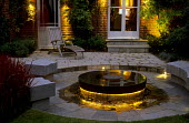 Stone water table, terrace, wooden deckchair, lighting, house, French doors