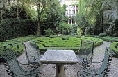 Table and chairs, view over parterre