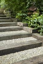 Railway sleeper steps, pebble paving