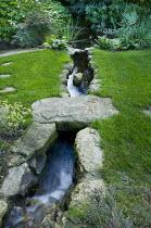 Stone edged stream, stone bridge