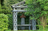 Wooden arbour, terracotta bust on plinth, bench