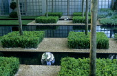 View of formal garden, topiary, canal, sculpture, galvanized panels