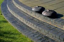 Brick steps, ceramic containers by Jennifer Jones