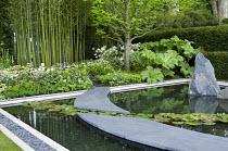 White border, bamboo, Kirby blue grey Burlington slate walkway, water lilies, gunnera