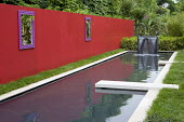 Red painted wall, rectangular pool, trompe l'oeil mirror