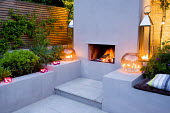 Outdoor fireplace and seating area, tealights on wall