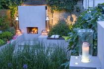 Evening in town garden, outdoor fireplace