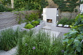 View across grasses to outdoor fireplace