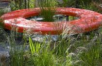 Circular red concrete bench