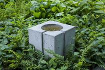 Shady garden, ferns, concrete birdbath