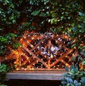 Bench in alcove, silver wreath, fairy light netting