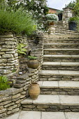 Terraced garden with stone steps, waterfall