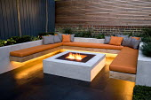 Seating area around brazier set into square table, bench cushions