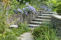 Stone steps, log wall