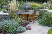 Autumnal planting around seating area, table and chairs