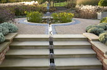 Circular pond, rill leading down steps