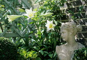 Stone bust with lilies