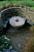 Sunken stone seating enclosure, table and chairs