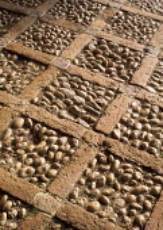 Decorative cobble and brick paving