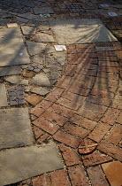 Mixed paving:stone, brick, tiles